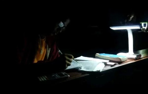 OAU students prepare for exams with torchlight, candle light
